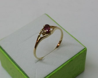 333 gold ring with a Ruby and diamond GR134
