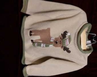 The cutest little boy or girl vintage reindeer sweater, big reindeers on  front with brown elbow patches on the back sleeves