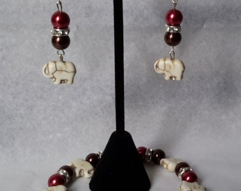 Beautiful, elephant charm, stretch bracelet and earring set. brown/red/silver.