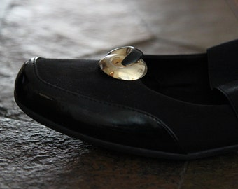 Gold and black shoe clips