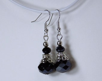 Earrings with black glass beads and silver-tone earrings