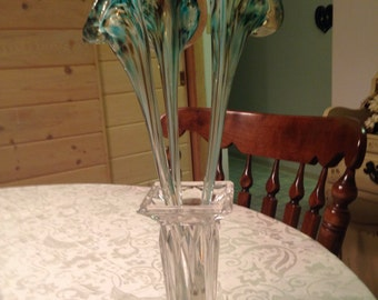 Stunning bouquet of hand blowen glass in a clear vintage vase