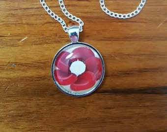 Red blood cell Rose Necklace.  Red blood cells arranged around a white blood cell.  Medical laboratory scientist