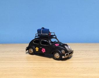Vintage black beetle car miniature with painted flowers,decorative collectible, VW bug,hippie car deco, retro collection,hippie style