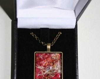 Square, antique bronze, textile art pendant.