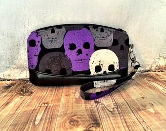 Clematis Wristlet in purple skull fabric and black vinyl