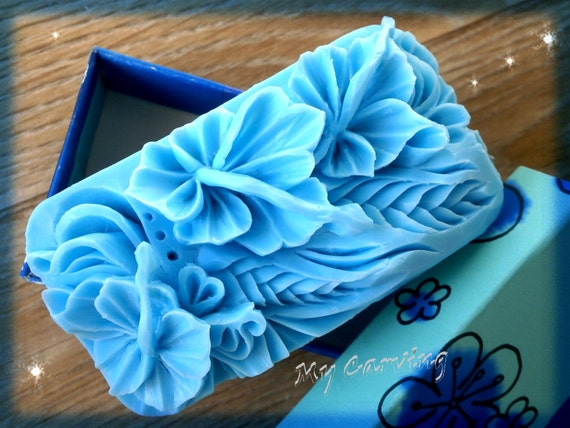 Items similar to hand carved soap blue hibiscus flower