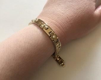 Vintage Costume Jewelry: Gold-Tone Rhinestone Tennis Bracelet