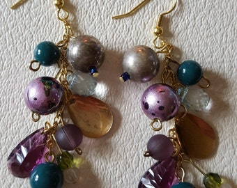 Purple and green dangling cluster earrings