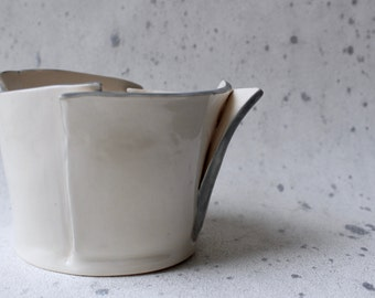 Origami-inspired ceramic vessel