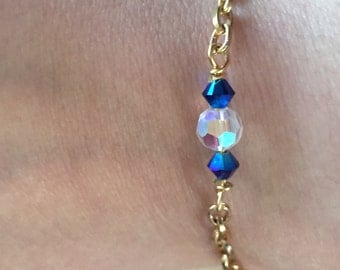 Blue and white crystal bracelet on gold chain