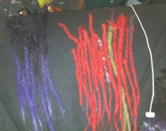 RED DREADLOCK EXTENSIONS.