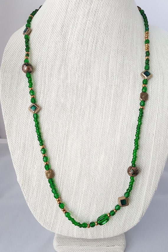 Long green and brass beaded necklace