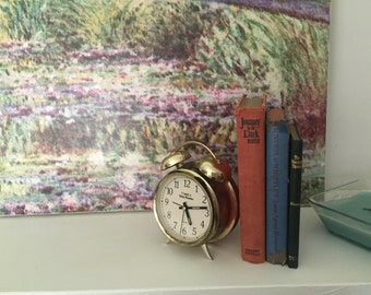 Vintage Books with ole brass clock