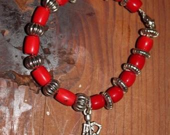 Coral bracelet with skeleton charm