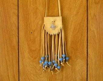 Cream deerskin leather pouch with a silver Butterfly Amulet, clay, glass and silver beads with long fringe
