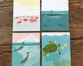 assorted cards / ocean