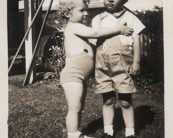 vintage photo Little Boy is Not happy w Attention from Baby Look at his Face!