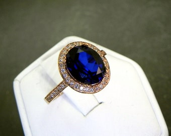 AAA Manmade Blue Sapphire   10x8mm  2.99 Carats   in a 14K ROSE gold engagement diamond halo ring .28cts TW Ring