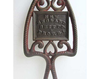 Antique 1900 Vintage Cast Iron New England Butt Co., Prov. RI, Advertising Footed Trivet with Partial Original Red Paint, Rope Border, Heart