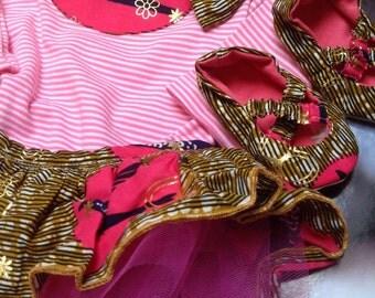 Baby girl's pink stripe tutu bodysuit with a detachable Ankara tutu, ballerina shoes and hairband