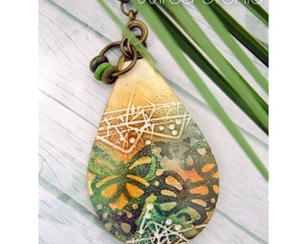 Polymer Clay Pendant Beach Boho Jewelry featuring Textured Butterfly Design in Dark Green, Orange, Yellow and White