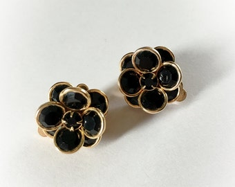 Vintage Black Rhinestone Framed in Gold Tone Metal Flower Earrings Clip On