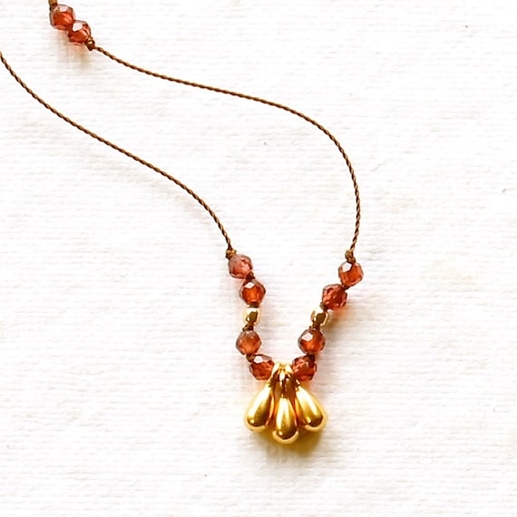 garnet knotted necklace on silk cord with by alisonblairstudio