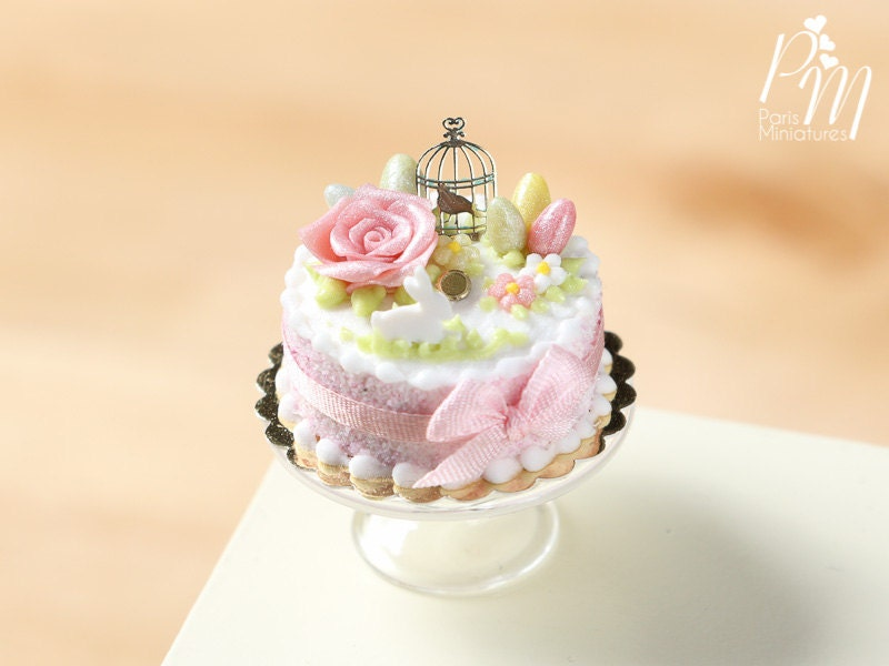 beautiful light pink easter cake with rose eggs rabbit