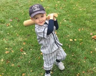 Baseball Uniform ,Grey with navy pinstripes.