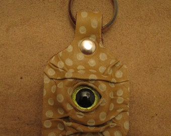 Grichels leather keychain - spotted tan with custom lime green glitter eye