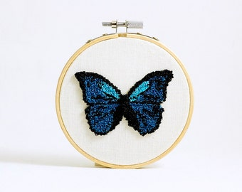 Ready to Ship! Punchneedle Blue Morpho Butterfly in a 4 Inch Hoop. Iridescent Blue. Embroidery Hoop Art. Fiber Art. Blue, Light Blue, White.