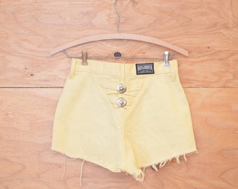 Vintage 80's High Rise Cut Off Jean Shorts In Yellow Unique Southwestern Conch Detail In Back SZ XS