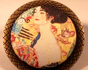 "Gustav Klimt fabric reproduction of "" Lady with a Fan"" on a bronze brooch"
