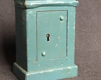 Locked for good. Antique rescued old used safe little money box. Restoration supply for broken toys renovation fans.