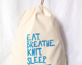 "Silkscreened Drawstring Knitting Project Bag ""Eat, Breathe, Knit, Sleep, Repeat"" in Blue"