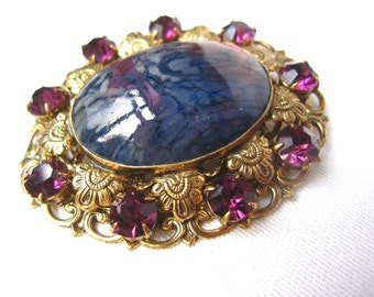 Large 1950s French filigree brass brooch with blue/purple resin stone and purple rhinestones
