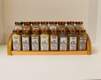 Vintage 1940s Griffith's Spice Rack with clear jars, copper lids and printed graphics