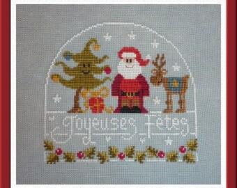 Trio de Fête Christmas cross stitch pattern by Jardin Privé at thecottageneedle.com holidays snowglobe Santa Claus