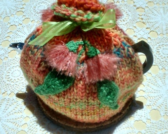 Floral Tea cozy hand knitted in wool and acrylic yarns in varying colours of orange, yellow, purple, & blue 4 - 6 cups
