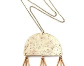 Oyo -- textured brass and triple fringe pendant necklace