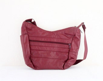 cranberry leather / vintage handbag
