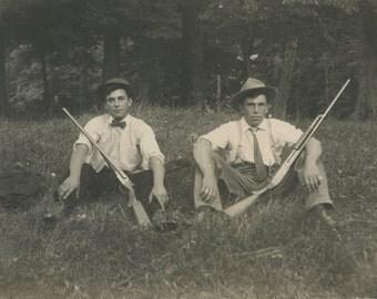 AZO Real Photo Postcard - gents and shotgun/rifles - UNUSED - fine condition