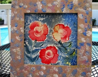 Red roses painted on a tile framed in wooden frame color coordinated
