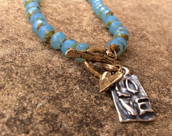 Boho knotted necklace - 'All heart' charm jewelry, aqua teal blue, mixed metal jewellery by mollymoojewels