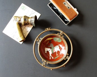 Vintage boho chic desk decor, tribal brass pipe, binoculars and trinket dish, bookshelf display