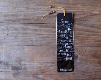 Fitzgerald, The great Gatsby black bookmark with handwritten calligraphy - boats against the current current