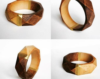Half and half wood geometric bangle with gold accent.