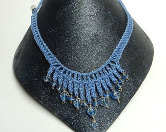 Crocheted statement necklace in light blue with blue, wire-wrapped glass heart beads