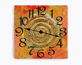 Red wall clock with a middle swirl and speckles. Square design.